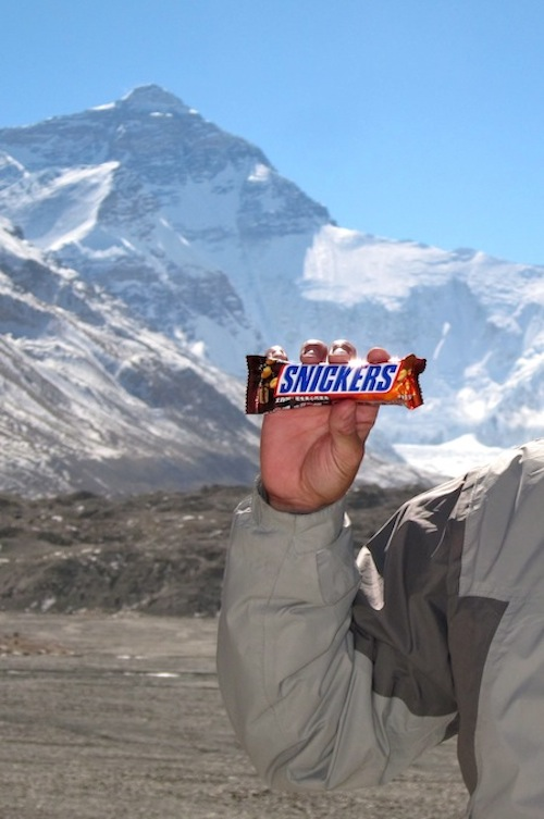 Enjoying a Snickers bar at Mt. Everest - Tibet